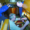 Citizen photo by Brent Braaten Left to right Jack McKinley, Dave Rubadeau and Mike Page work on the pipe organ at Knox United Church.