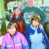 Citizen photo by Brent Braaten Doreen Gauthier with her children Holland, 10, Jazzlynne, 4, front left and Josephine, 5, front right. She is scared to let her children play outside their home in the Spruce capital Trailer Park along Pulpmill Road because of cougar sightings in the area.