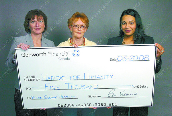 Citizen photo by Brent Braaten Cathy Weber, left, and Narrinder Dhanoya-Bhange, right, present Joanne Pickering with Habitat for Humanity with a cheque for $5,000 to go towards the flooring in the duplex project they are building.