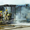 Citizen photo by David Mah Prince George Firefighters enter #71 at the Lombardy Mobile Home Park on Norwood Street as the home was engulfed Thursday afternoon.