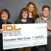 Citizen photo by Brent Braaten Prince George- Mount Robson  MLA Shirley Bond, Christine Finnerty Public Affairs Red Cross annd Gerrilyn Schembri, Red Cross volunteer receive a cheque for $8,471 from Todd Patterson with IDL Projects. The money is for the victims of the ice jam and flooding on the Nechako River. IDL did the work of raising the road and putting the gabion diking. Besides the amount donated by IDL,  the 15 local trucking contractors that worked on the project donated $3,471 to bring the  total to $11,942.