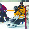 Citizen photo by David Mah Manitoba Belle goalie Erica Bohemer saves a shot from Kimberly Sumpter of Team BC.