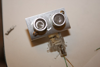 """Bracket fabricated to mount the sonar """"eyes"""" onto the motor"""