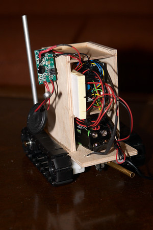 I hacked a little sampling circuit board, removing the pushbuttons and soldering up wires so the robot can trigger the record and playback functions