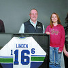 Citizen photo by Brent Braaten Michael Rochon, left, Scotia Bank, Dennis Nore, Canadian Cancer Society and Nicole Carswell, right, Scotia Bank, present Ashlee Wiskin, 8, with her prize of a Trevor Linden jersey. The raffle was a fundraiser for the Canadian Cancer Society and tickets were sold aat the Scotia bank branches. The raffle raised $1,430.