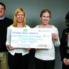 Citizen photo by Brent Braaten Justin speer, left, Integris Credit Union, Brenda Astorino, right, Integris Credit Union present Kaethe Clark and Aoibhinn Grimes second year Northern Medical Program students with a cheque for $1,500 for the 'Run for Rural Medicine' a fundraising run being held Saturday April 5th.