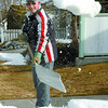 Citizen photo by David Mah Vince Fuoco breaks up snow on his lawn on Oak Street to speed up the melting process.