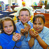 Citizen photo by David Mah St. Mary's Elementary students Shaundra Headrick, left, Taylor Marko, and Isabelle Thomas, all 7,  from Mrs. McEachen's grade 2 classs how 3 of the classe's 16 chicks that hatched Monday and Tuesday.