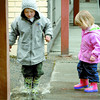 Citizen photo by Brent Braaten Lance Shelke, 4, and Kendra Holland, 2, find a puddle to play in along Victoria Street Tuesday afternoon.