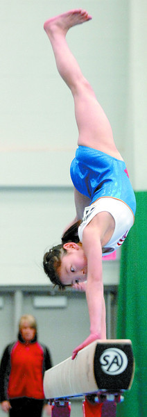 Citizen photo by Brent Braaten Lina Goto competeing on the balance beam Saturday at the 2008 Del-Tech Manufacturing Inc. Western Canadian Gymnastics Championships at the Northern Sports Centre.