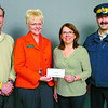 Citizen photo by David Mah Dr. Patrick Turner,left, Martina Humphrey from TD Canada Trust, Lorraine Beach, Prevent Alcohol and Risk Related Trauma in Youth coordinator, and RCMP Const. Gary Godwin show the $1000.00 cheque presented from TD Canada Trust to the PARTY Program.