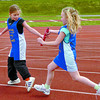 Citizen photo by David Mah Karlea Simmonds, right, and Grace Waldie, both 9, pass the baton for their Highglen Elementary School team in the Elementary School Relays held at Masich Place Stadium.