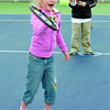 Citizen photo by David Mah Sylvia Masich, 6, left, Royce Gaites, 7, and Demian Dron, 7, took Mini Tennis lessons from Patricia Van Hage at the Prince George Tennis Club Wednesday.