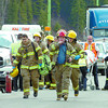 Citizen photo by David Mah Prince George Firefighters and BC Ambulance attendants leave the Simon Fraser Bridge at noon Wednesday after a 3 vehicle accident in the west bound lane blocked traffic. There were no serious injuries.