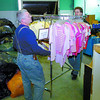 Citizen photo by David Mah Mike Reimer, left, and Stephen Inwood move another rack of close to the store front of the new Salvation Army Thrift Store in the Parkhill Centre Truck loads of merchandise has been moved from the old location on 20th Avenue.