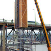 Citizen photo by David Mah Surespan crews used a large crane to place a form in preparation to pour 90 cubic meters of cement to make a tower at the east end of the Simon Fraser Bridge.
