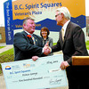 Citizen photo by David Mah Mayor Colin Kinsley, left, accepts a $500.00 cheque from Premier Gordon Campbell which will help refurbish the cenotaph on the City Hall grounds.