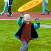 Citizen photo by David Mah Adam Blackwell, 6, enjoyed the flying disc while walkers made their way around the track.