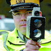 Citizen photo by David Mah RCMP Constable Corey Eggen takes laser reading for speeders on Continental Way Wednesday. Canada Traffic Safety Week is in full swing, especially this weekend.