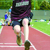 Citizen photo by David Mah Emma Balazs, 13, from Heather Park Middle School competes in the triple jump in the Elementary School Track Meet at Masich Place Stadium.