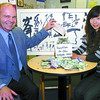 Citizen photo by David Mah CNC President John Bowman donates $1000.00 on behalf of the College to add to the over $800.00 raised by CNC International Studies students, the China Taste Restaurant, and the China Cup Restaurant to be donated to the Red Cross for earthquake relif in China. Shown in the photo with Bowman is Susie Sun. Sun's uncle in China donated 10 pieces of art which are selling at the China Taste Restaurant.