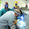 Citizen photo by David Mah Wade Gott, left, Brian Johnson, and Ray Kenny test a welder at the Praxair demo days. Many products were available for testing Thursday.