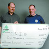 Citizen photo by Brent Braaten Jeff Elder with CNIB accepts a cheque for $1,000 from Ed McEwan with BC Hydro HYDRECS ( BC Hydro Community Services Fund. The money will be used for Visions Luncheon.