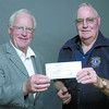 Citizen photo by Brent Braaten Les Waldie, President of the Community Foundation accepts a cheque for $2,500 from Erery Cawsey, Spruce City Lions Club for the Bob Goode endowment fund.