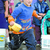 Citizen photo by Brent Braaten Dawson Frankforth, 6, competes in the sponge race with determination during the cedars Christian School sports day Friday at the school.