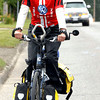 Citizen phot by Brent Braaten Dave Livingston rides along Queensway after stopping in to Hub City Motors Friday morning during his 3 month trip across Canada by bike to raise money for the B.C. Lung Association. Karl Schleich with Hub City Motors presented him with a cheque for $500. Volkswagon dealer from across Canada are sponcering his ride. Livingston wants to be in Edmonton by June 22nd to celebrate his 66th Birthday.