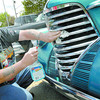 Citizen photo by Brent Braaten Dick Colarosa shines up the grill to his 1938 Oldsmobile prior to a tour of seniors homes around town. Members of Crusin' Classics Car Club toured Parkside, Rainbow, Jubilee and Simon fraser Friday afternoon. The big fathers day show and shine is Sunday downtown.