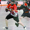 Citizen photo by David Mah Mitchell Marsolais of the Prince George Posse evades a Terrace Raider as he goes for the net.
