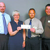 Citizen photo by David Mah Craig Lee, left, from College Heights Save-On Foods, Donalda Carson from Prince George Hospice Society, Len Steenson, Spruceland Save-On Foods, and Ted Pigeon, Parkwood Save-On Foods, show the $5,724.00 cheque raised for Hospice in January and March through the scanning program which changed Save-On Points to dollars.