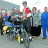 Citizen phot by Brent Braaten Dave Livingston stopped in to Hub City Motors Friday morning during his 3 month trip across Canada by bike to raise money for the B.C. Lung Association. Karl Schleich with Hub City Motors presented him with a cheque for $500. Livingston wants to be in Edmonton by June 22nd to celebrate his 66th Birthday.