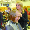 Citizen photo by David Mah Cedars Christian School student Kyla Eby, 13, has her head shaved by Kristin Huebert from Loxx Academy at the fundraiser for grade 5 student Sam Goertzen. Sam has Acute Lymphoblastic Leukemia. At haircut time $9795.16 had been raised for the family. The target was $4,000.00