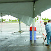 Citizen photo by David Mah Brad Rogers, left, and Melvin Morin of LA Promotions set up the Ford tent in preparation for the Mega Sale at the CN Centre parking lot.