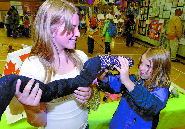 Citizen photo by David Mah Malaspina Elementary school students Bailey Fraser, 13, left, and her sister Katelyn, 8, take a close look at their brother Jeremy's Sock Animal which was part of the school's Art Showcase.