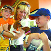 Citizen photo by David Mah Hunter Fanshaw, 6, left, his mom Marie and brother Caden, 9, played with mini dachshund puppies at the grand opening of Petland Saturday. The colorful, spacious store had many visitors.