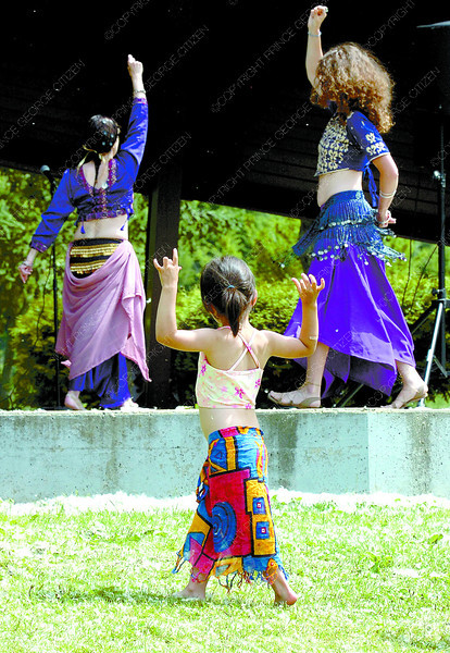 Citizen photo by David Mah Four-year-old Raia Patrick-Prince immitated belly dancers Julie Horning, left, and Emma Faulkner at National Aboriginal Day at Fort George Park Saturday. The gathering was in celebration of children.