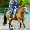 Citizen photo David Mah Carlene McComber, 12, front, and Anna Witte, 13, had fun and laughs riding Carlene's horse Stormy around in the outdoor arena in the Prince George Exhibition grounds Wednesday evening.