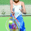 Citizen photo Brent Braaten Lezzyl Aquino, 9, a grade 3 student at Sacred Heart School returns a serve during tennis lessons at the Prince George Tennis Club on Recreation Place. This was the classes second lesson.