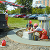 Citizen photo Brent Braaten City of Prince George employees left to right Parm Bhatal Matt Bender and David Dalgleish work at placing pedestals for the Terry Fox statue at Community Foundation park Wednesday afternoon.