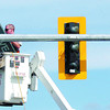Citizen photo by David Mah City of Prince George electrician Danny Bouey sets up the new traffic lights at 15th Avenue and Ospika Boulevard. The signals have the protect-only phase where left-turning traffic on Ospika turns only on a green arrow and stops on a red arrow.
