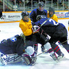 Citizen photo by David Mah Team blue goalie Ty Gullickson covers up as Dylan DeSousa, center, is knocked over him by Michael Jorgenson in the Cariboo Cougars camp at the Prince George Coliseum.