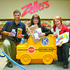 Citizen photo by Chuck Nisbett Citizen Business Development Manager Alan Ramsay (left), Pine Centre Marketing Director Virginia Dekker, and Salvation Army Community Ministries Coordinator Barbara Croome kick off the campaign for school supplies Monday at the Pine Centre Mall.