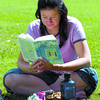 Citizen photo by David Mah Leanna Garraway found some quiet time at lunch time to catch up on her book The Eyre Affair. Leanna had most of Fort George Park to herself.