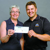 Citizen photo by David Mah Donalda Carson, executive director of the Prince George Hospice House receives a $3500.00 cheque from Matt Major from the Treasure Cove Casino.