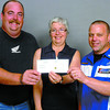 Citizen photo by David Mah Charles Brunette, left, from the BC Coalition of Motorcyclists and Garry Logan from NR Motors present Donalda Carson, executive director Prince George Hospice House with a $500.00 cheque. The money was raised at the June 7 demo days at NR Motors.