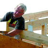 Citizen photo by David Mah City of Prince George carpenter Alf Mills squares up the trusses of the 1200 square foot shop at the Prince George Cemetary.