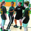 Citizen photo by David Mah UNBC Timberwolves Basketball Camp participants Morgan McKee, left, watch Timberwolf Soili Smith set up a block with Haylea Bryce and Kristen Greene during Wednesday's camp at the Charles Jago Northern Sport Centre.